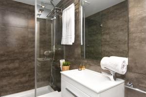 Ett badrum på Mercedes Heritage Apartments