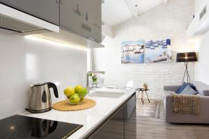 A kitchen or kitchenette at Mercedes Heritage Best Barcelona Apartments