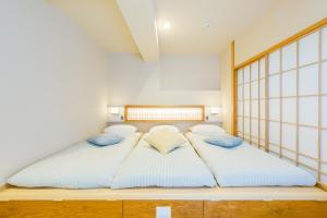 KAGO 34 by Shukuba HOTELにあるベッド