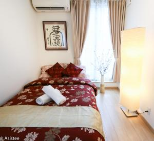 A bed or beds in a room at 1 Bedroom Apartment Otsuka TP #002