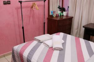 A bed or beds in a room at Appartement Deroua Casablanca