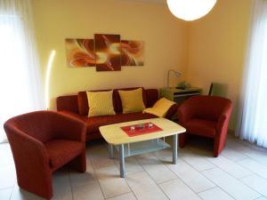 A seating area at Ferienwohnungen Uhlemann - nur 15 Minuten bis in die Altstadt