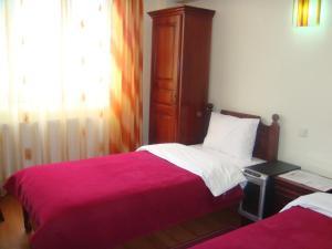 Кровать или кровати в номере Vila Corola