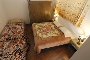 Cama o camas de una habitación en Departamento en Cusco