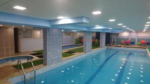 The swimming pool at or near Noor Hotel Apartments