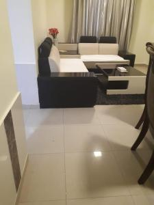A seating area at Reef Hotel Aparts (Tabasum Group)