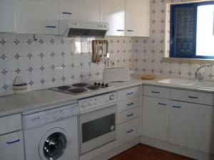 A kitchen or kitchenette at Mantasol