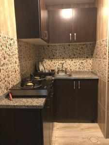 A kitchen or kitchenette at Noor Hotel Apartments