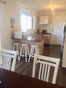 A kitchen or kitchenette at Hunter Homestay