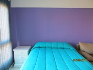 Una cama o camas en una habitación de FAM bariloche