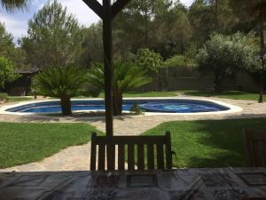 The swimming pool at or near Loft Cerca de Sitges