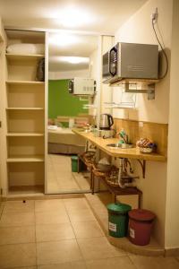 A kitchen or kitchenette at AVEMAR Apart Hotel