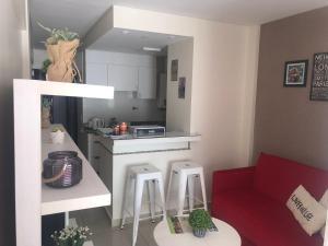 Una cocina o kitchenette en 9 de Julio Park Suites