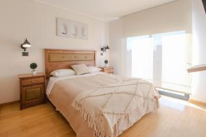 Cama o camas de una habitación en AlojaRent Malaga