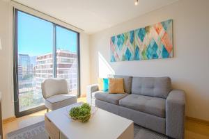 Zona de estar de AlojaRent Malaga