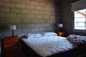 Una cama o camas en una habitación de Gorriones Libres