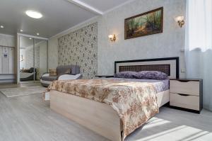 Кровать или кровати в номере New apartamenty na Plekhanova 14