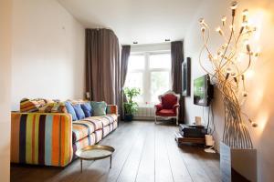 Ein Sitzbereich in der Unterkunft Luxury Canal Apartment