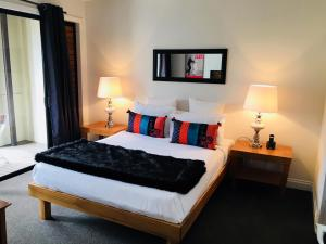 A bed or beds in a room at Latitude 37