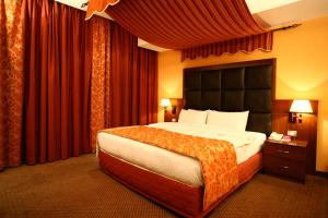 A bed or beds in a room at Markazia Suites