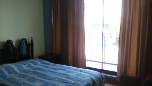 Cama o camas de una habitación en Departamento Amoblado