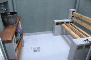 A kitchen or kitchenette at Apartamento Requintado no Gasômetro