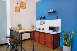 A kitchen or kitchenette at Amai Art Home