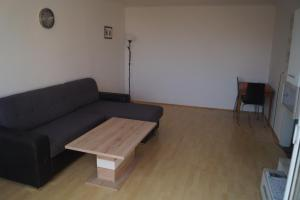 A seating area at Herbststrasse Apartment