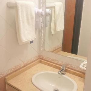 Un baño de Apartamentos Mendoza