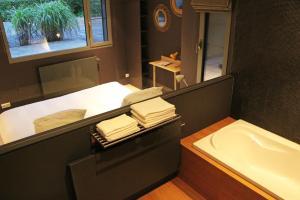 Salle de bains dans l'établissement Archibien
