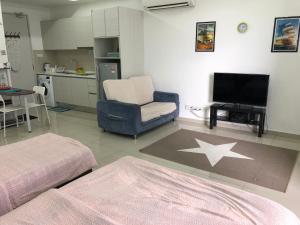 A seating area at I-City I-Soho Chamey Homestay Condo, Shah Alam
