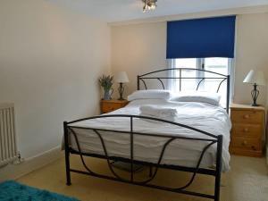 Posteľ alebo postele v izbe v ubytovaní Cross House