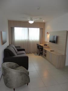 A seating area at Lindo Flat em Boa Viagem 2 qtos