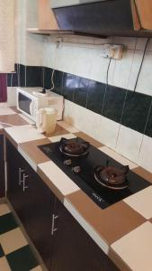 A kitchen or kitchenette at Anba@Villa Dahlia
