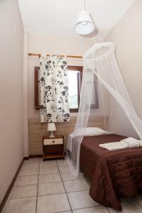 Un ou plusieurs lits dans un hébergement de l'établissement Eleana apartments and studios