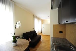 Area soggiorno di Corvetto Residence Porto Di Mare