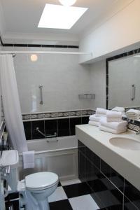 A bathroom at Arlington Suites