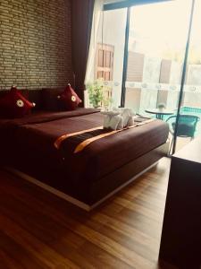 Voodi või voodid majutusasutuse KG Private Pool Villa toas