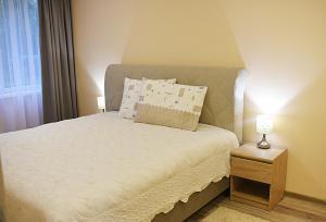 Tempat tidur dalam kamar di Apartments Victoria