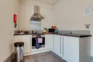 A kitchen or kitchenette at Base Serviced Apartments - City Road