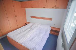 Een bed of bedden in een kamer bij Edelhert