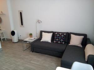 A seating area at Coqueto apartamento en el centro de Frigiliana
