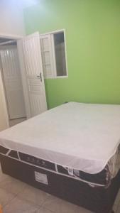 Cama ou camas em um quarto em Chalés e Kitnet da Margarida