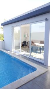 The swimming pool at or near Paradise Terrace House