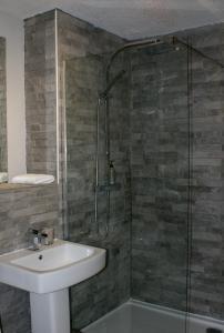 A bathroom at No.27 Ayr Beach - Coorie Doon