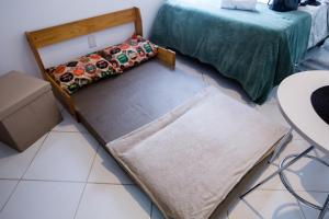 A bed or beds in a room at Sossego na Cidade Baixa