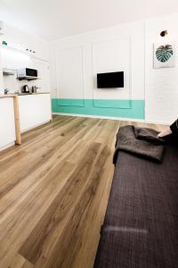 A television and/or entertainment centre at ECOLOFT studio