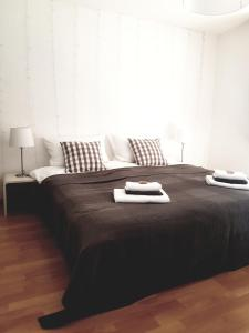 A bed or beds in a room at Feldberg-Holiday