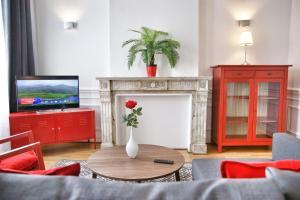 Zona de estar de ApartmentsApart