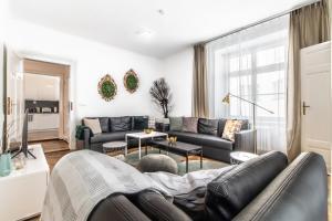 Posezení v ubytování City Square Apartments